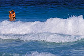 man stock photography | Antigua, Half Moon Beach, couple in surf, image id 4-602-51