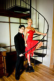 male stock photography | Argentina, Buenos Aires, Tango dancers standing on spiral staircase, image id S8-451-10591