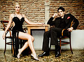 laid back stock photography | Argentina, Buenos Aires, Tango dancers, seated, image id S8-451-10997