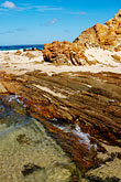 vertical stock photography | Australia, Victoria, Mallacoota, Rock formations on beach, image id 5-600-1870