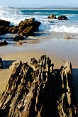 vertical stock photography | Australia, Victoria, Mallacoota, Rock formations on beach, image id 5-600-1898
