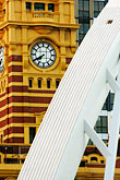 yellow curve stock photography | Australia, Melbourne, Flinders Street Station and Yarra Pedestrian Bridge, image id 5-600-2199