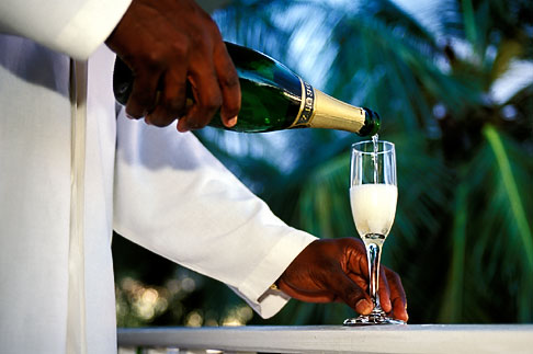 image 3-480-41 Barbados, St James, Man pouring champagne