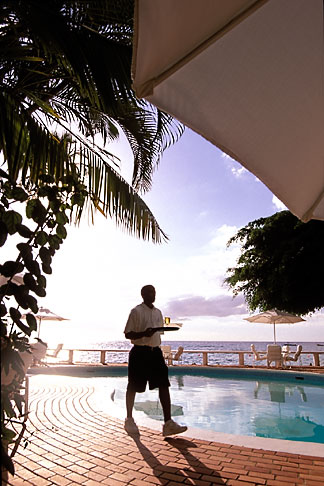 image 3-493-85 Barbados, St Peter, Cobblers Cove, waiter at pool