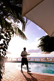 sunlight stock photography | Barbados, St. Peter, Cobblers Cove, waiter at pool, image id 3-493-85
