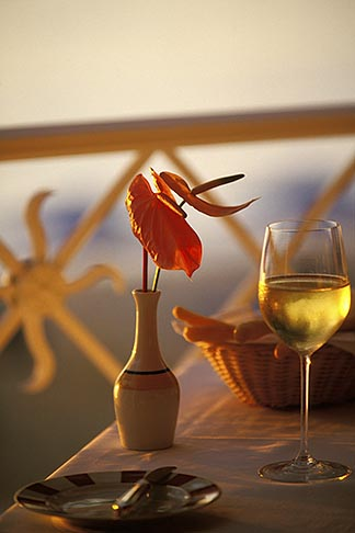 image 3-495-51 Food and Drink, Glass of white wine and anthurium in vase on table outdoors,