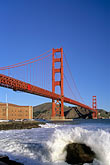 suspension bridge stock photography | California, San Francisco, Golden Gate Bridge and Fort Point, surf on rocks, image id 1-62-59