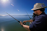 one person stock photography | California, San Francisco Bay, Sturgeon Fishing, San Pablo Bay, image id 2-221-23