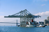 horizontal stock photography | California, San Francisco Bay, Port of Oakland cranes approaching the Bay Bridge, image id 2-420-29