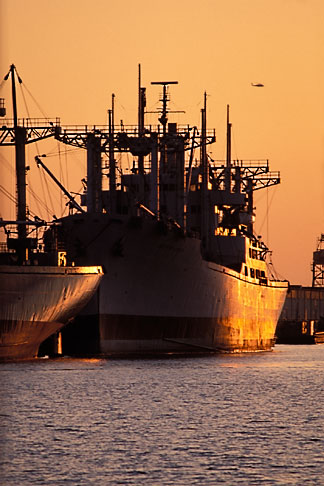 image 3-279-2 California, Oakland, Freighters at sunset in Inner Harbor