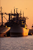 cargo stock photography | California, Oakland, Freighters at sunset in Inner Harbor, image id 3-279-2