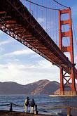 two people stock photography | California, San Francisco, Golden Gate Bridge from Fort Point, GGNRA, image id 4-504-34