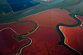 red stock photography | California, San Francisco Bay, Aerial view of salt evaporation ponds, image id 4-850-5412