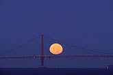 water stock photography | California, San Francisco Bay, Moon behind Golden Gate Bridge, image id 7-463-30