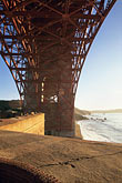 vertical stock photography | California, San Francisco, Fort Point beneath Golden Gate Bridge, image id 8-721-2