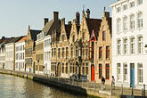 old house stock photography | Belgium, Bruges, Old houses alongside canal, image id 8-740-747