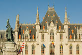 statue stock photography | Belgium, Bruges, Provincial Palace and statue of Jan Breydel and Pieter de Coninck, Market Square, Brugge Markt, image id 8-740-765
