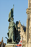 statue stock photography | Belgium, Bruges, Statue of Jan Breydel and Pieter de Coninck, with Provincial Palace, image id 8-740-783