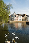 vertical stock photography | Belgium, Bruges, Canal and sculpture of white birds, image id 8-741-2111