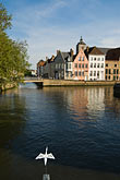 vertical stock photography | Belgium, Bruges, Canal and sculpture of white bird, image id 8-741-2112