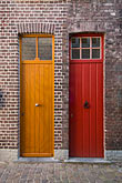 vertical stock photography | Belgium, Bruges, Painted doors and brick wall, image id 8-741-2119