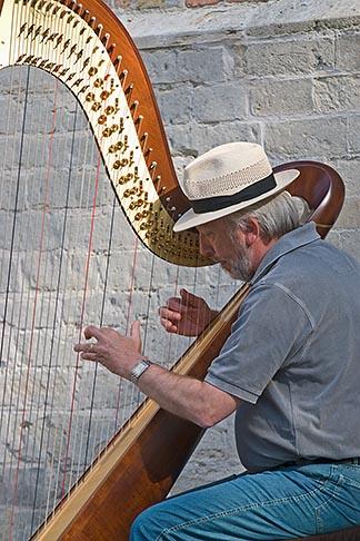 image 8-741-2222 Belgium, Bruges, Man playing harp, seated