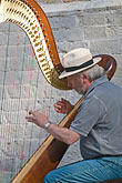 vertical stock photography | Belgium, Bruges, Man playing harp, seated, image id 8-741-2222