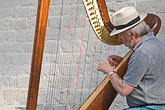 man stock photography | Belgium, Bruges, Man playing harp, seated, image id 8-741-2224