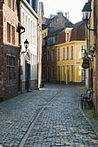 narrow stock photography | Belgium, Bruges, Narrow cobbled street with houses, image id 8-741-2260