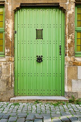 image 8-742-1443 Belgium, Ghent, Painted doorway and cobbled street