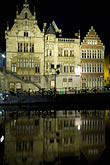 vertical stock photography | Belgium, Ghent, Gabled guild houses on Graslei canal at night, image id 8-742-1584