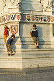 children playing at base of statue stock photography | Belgium, Ghent, Children playing at base of statue, image id 8-742-2019