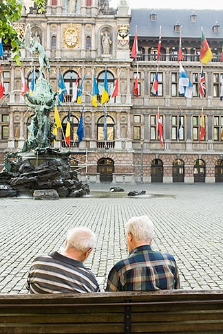 image 8-744-2177 Belgium, Antwerp, Two men on bench in Grote Markt in front of Town Hall, Stadhuis, and Brabo statue