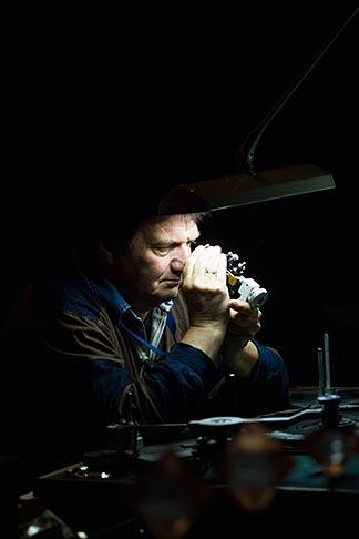 image 8-745-2715 Belgium, Antwerp, Jeweler examining a diamond at the Diamond Museum