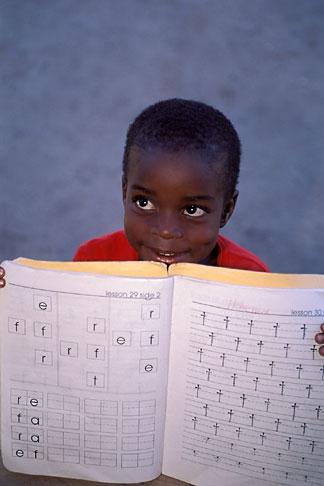 image 6-46-33 Belize, Hopkins Village, Garifuna boy with schoolwork