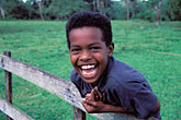 solo portrait stock photography | Belize, Young boy laughing, image id 6-91-9