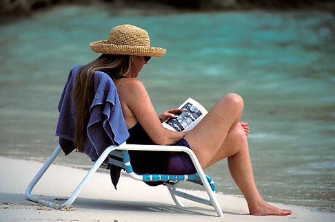image 1-600-8 Bermuda, Woman reading on the beach