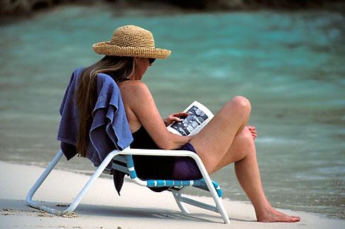 image 1-600-8 Bermuda, Woman reading on the beach