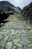 walking on stone pavement stock photography | Bolivia, Andes, Hikers on Inca Trail to Taquesi , image id 3-118-33