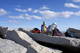 seated outdoors stock photography | California, Mt Whitney, Climbers on summit of Mount Whitney at 14495 feet, image id 2-113-35