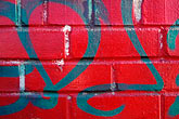 red stock photography | Patterns, Red brick wall with graffiti, image id 3-1015-20