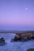 vertical stock photography | California, Point Arena, Rock arch at mouth of Garcia River with full moon, image id 4-796-16