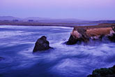 calm stock photography | California, Point Arena, Rock arch at mouth of Garcia River, image id 4-796-19