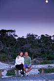in line stock photography | California, Pacific Grove, Asilomar State Beach, couple at sunset, image id 4-987-59