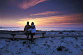 look down stock photography | California, Pacific Grove, Asilomar State Beach, couple at sunset, image id 4-987-77
