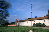 horizontal stock photography | California, Missions, La Purisima Mission church and Spanish flag, image id 5-124-35