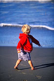 shore stock photography | California, Santa Cruz County, Pajaro Dunes, Boy on beach, image id 5-671-52