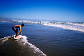 shore stock photography | California, Santa Cruz County, Pajaro Dunes, Skimboarder, image id 5-672-43