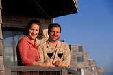 wine tourism stock photography | California, Santa Cruz County, Pajaro Dunes, Couple on balcony, image id 5-673-62