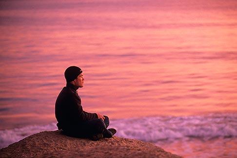 image 7-600-89 California, Santa Cruz, Man meditating at sunset